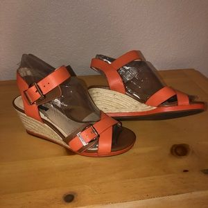 Orange leather wedge sandals with gold buckles